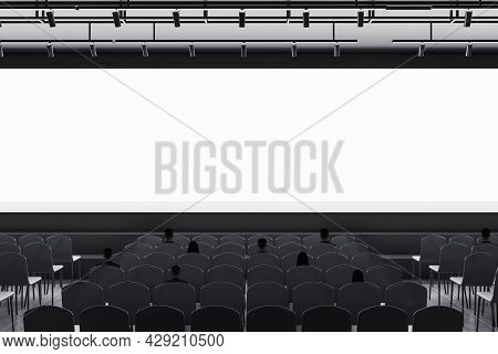 People In Modern Grey Auditorium With Seating And Empty Screen With Mock Up Place For Your Advertise