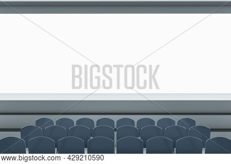 Clean Grey Auditorium With Seating And Empty Screen With Mock Up Place For Your Advertisement. Show