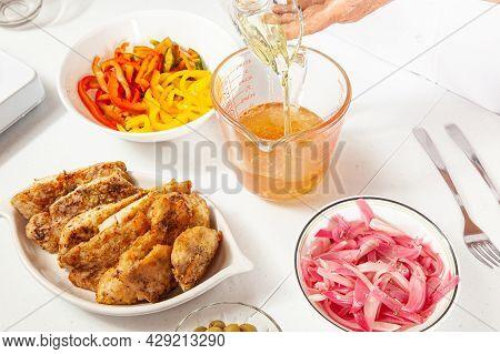 Fish Marinade Preparation Steps: Mixing Vinegar And Oil To Marinade Sea Bass