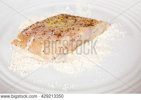 Fish Marinade Preparation Steps: Covering Sea Bass Pieces In Flour