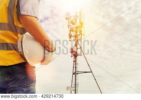 Rear View Male Technician Engineers Wearing Safety Protective Clothing Work High Tower Telecommunica
