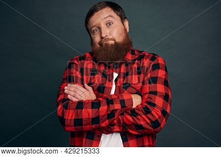 Close-up Shot Serious Bearded Attractive Man Thinking, Tilt Head As Weighing What Product Buy, Consi