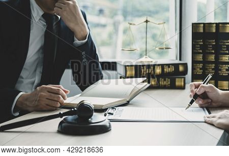 Businessman Hand Sign After Lawyer Providing Legal Consult Dispute Service At The Office With Justic