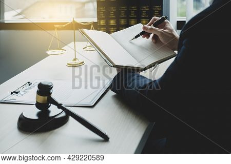 Lawyer Hand Holding Pen And Providing Legal Consult Business Dispute Service At The Office With Just