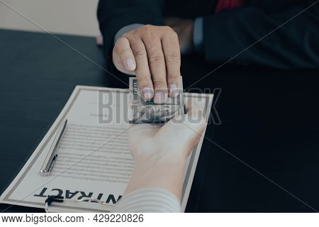 Businessman Hand Holding Dollar Bank Note Money To Bribe Financial Officials Or Boss Is Payout Staff