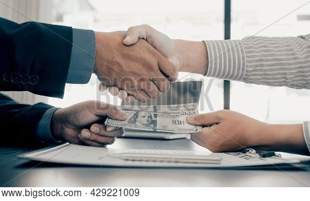 Hands Shaking, Government Officials Receiving Bribe Money From Businessman, The Concept Of Corruptio
