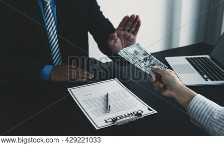 Government Officials Raise The Hand Refusing Money To Take The Bribe From Businessman, The Concept O