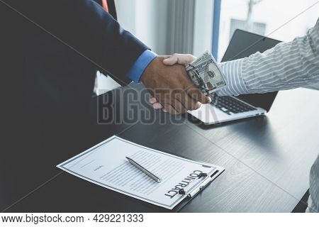 Government Officials Hand Receiving Bribe Money From Businessman In Shaking Hands, The Concept Of Co
