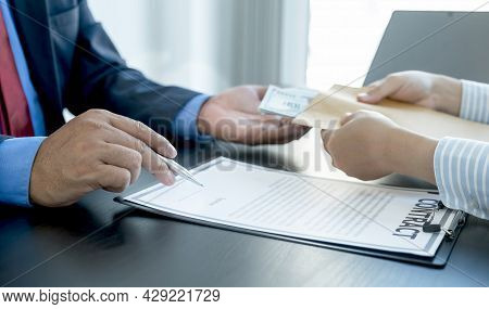 Government Officials Hand Sign The Contract And Receiving Bribe Money From Businessman, The Concept