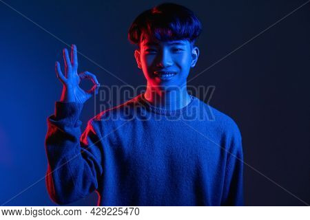 Okay Gesture. Approval Sign. Perfect Choice. Cyberpunk Style. Happy Asian Man Guarantees Best Qualit