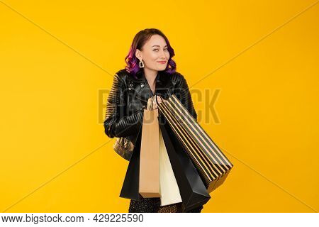 Shopaholic Lifestyle. Happy Woman. Hot Sale. Holiday Discount. Pretty Joyful Lady Looking Satisfied
