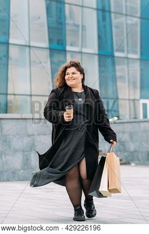 Shopaholic Lifestyle. Happy Woman. Black Friday. Holiday Sale. Joyful Plus Size Lady Stylish Casual