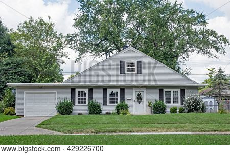 Simple Gray A Frame House with Black Shutters