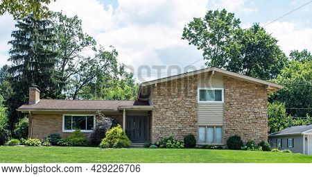 Tan Flagstone House with Various Shrub Landscaping
