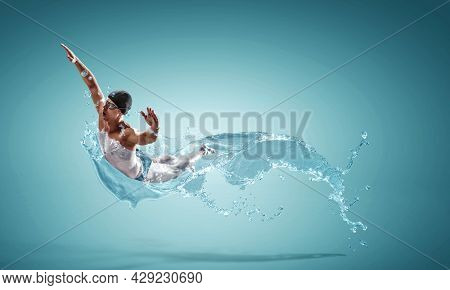 Professional man swimmer on a wave