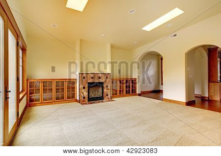 Large Empty Room With Fireplace And Shelves. New Luxury Home Interior.