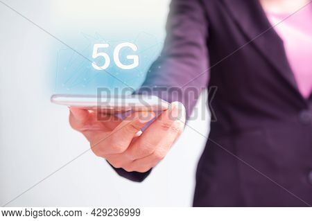 Staff Woman Holding Mobile Phone With 5g Text And Signal Symbols. Communication Data Information Con