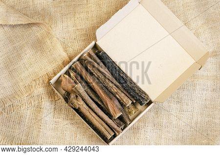 Full Cardboard Pet Treat Box On Burlap Fabric. Dried Dog Goodies. Tasty Beef Tripe Sticks. Bovine St