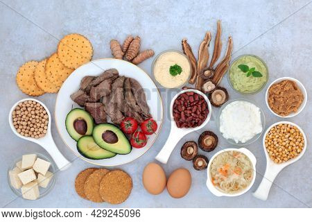 Super food for bipolar disorder and manic depression with health foods high in omega 3, protein, vitamins, selenium, magnesium, serotonin and tryptophan. Health care concept. On marble.