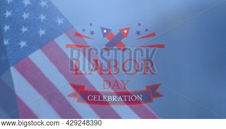 Image of labour day celebration text with fireworks over american flag on blue. patriotism, independence and celebration concept digitally generated image.