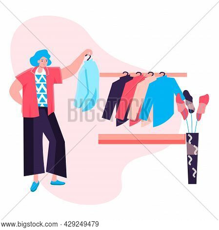 Shopping Woman Concept. Customer Chooses Fashionable Stylish Outfit From New Collection Of Clothes,