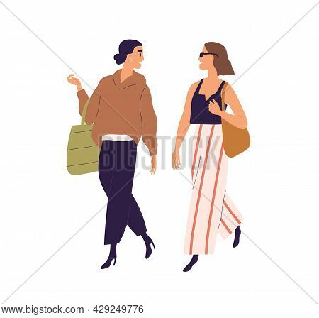 Women Friends Walking And Talking. Happy Relaxed Young Girlfriends Strolling Together. Modern People