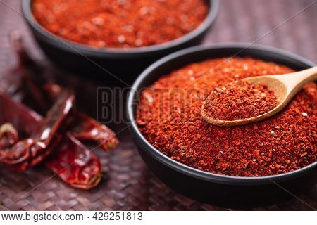 Red Chili Pepper Powder In A Bowl With Spoon, Chili Flakes