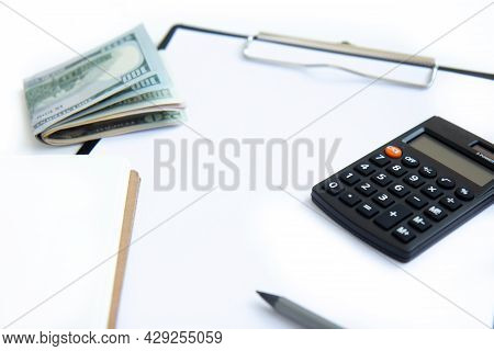 Calculator, Paper Money And Notebook Isolated On White Background. Concept Of Debt Management, Payme