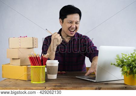 Small Business Owners Are Rejoicing That The Business Is Doing Well, Man Preparing A Parcel For Deli