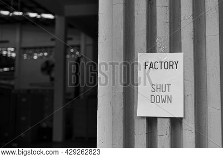 Factory Shut Down Sign In Front Of The Factory Warehouse. Business Shutdown Because Of Economic Rece