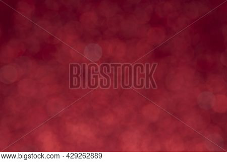 Snow Bokeh Backgrounds Color Red. Abstract Background Of Blurred Lights With Bokeh Effect. Red Glitt