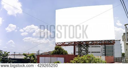 Blank White Road Billboard With Bangkok Cityscape Background At Day Time. Street Advertising Poster,