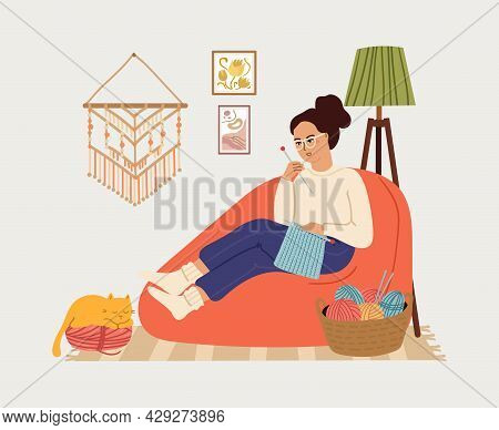 Girl Knit. Knitting Clothes, Woman Relaxing In Big Chair. Cozy Scandinavian Interior With Young Fema