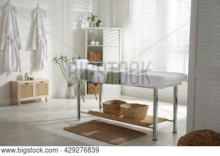 Stylish Spa Salon Interior With Massage Table