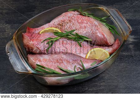 Raw Redfish Carcasses Without Heads, Also Known As Ocean Perch, Prepared With Spices For Baking In G