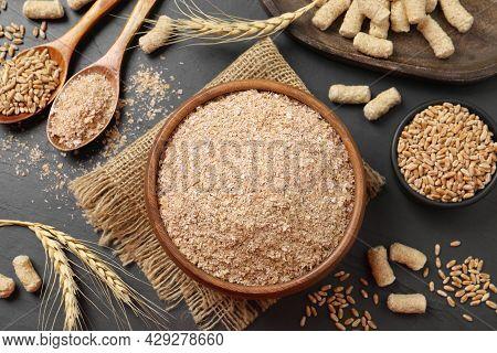 Wheat Bran On Black Table, Flat Lay