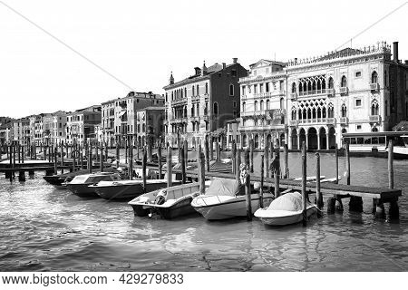 Venice, Italy - June 13, 2019: View Of Grand Canal With Different Boats At Pier. Black And White Ton