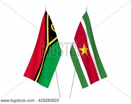National Fabric Flags Of Republic Of Vanuatu And Republic Of Suriname Isolated On White Background.