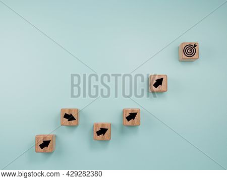 Virtual Target Board And Arrow Which Print Screen To Wooden Cube Block On Blue Background. Business