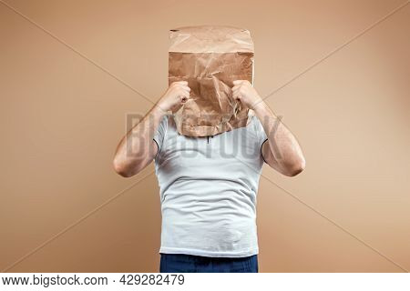 Men Put A Paper Bag On Their Heads, Upset, In A Bad Mood, Crying. Isolated On Yellow Background, Ima