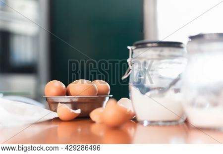 Chicken Eggs In A Bowl With Bakery Ingredients On Table