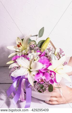 Man's Hands Are Holding Bouquet. A Beautiful Bouquet Of Fresh Flowers On A White Background