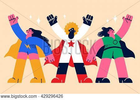 Superheroes Women And Superpower Concept. Positive Confident Female Hero Characters In Hero Costumes