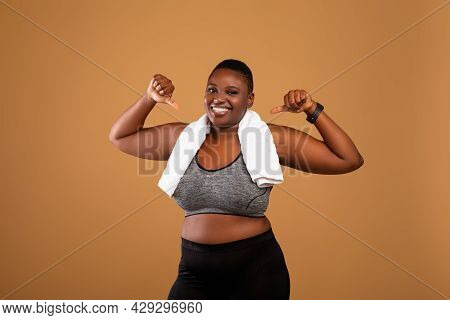 Chubby Black Woman In Sportswear Pointing At Herself