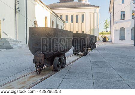 Historical Black Wagons Of Coal Mine. Wagons On The Tracks.