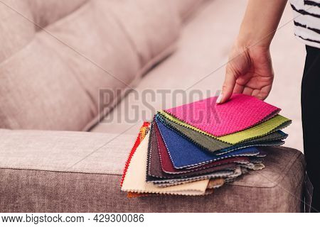 Woman Chooses The Colors And Patterns Of Upholstery Fabrics. Textile Industry Background. Tissue Cat