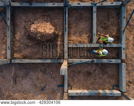 Top View Team Engineer Working Inspection Beam Structure Installation In Construction Site.