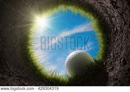 Golf Ball Is Falling Into Hole. View From Inside Of Hole. 3d Rendered Illustration.