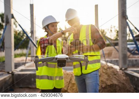 Selective Focus, Team Survey Use Drone For Aerial View Structure Inspection In Construction Site. Te