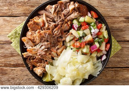 Hawaiian Slow Cooked Kalua Pork Served With Cabbage And Salad Close-up On A Plate On The Table. Hori